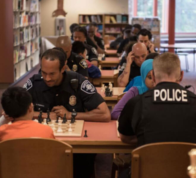 Seattle (Washington) Police Department playing chess with community members
